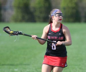 Guilderland's Hayley Kmack scans the field for opportunities during Thursday's Suburban Council girls' lacrosse matchp at Niskayuna High School. (Ed Burke-Special to The Times Union)